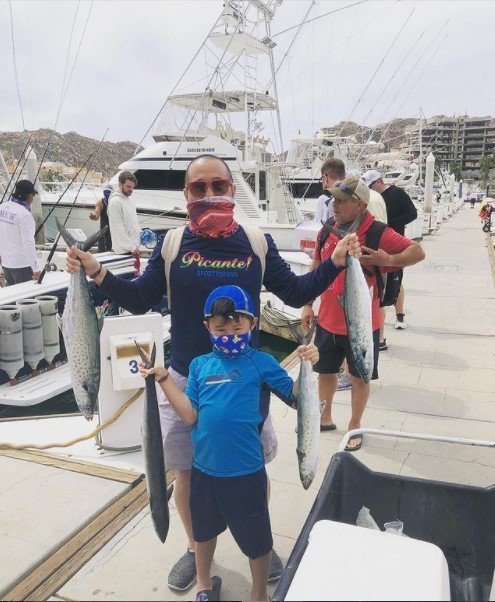 Family fishing aboard Picante 45